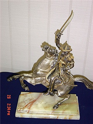 Silverplate man on horse